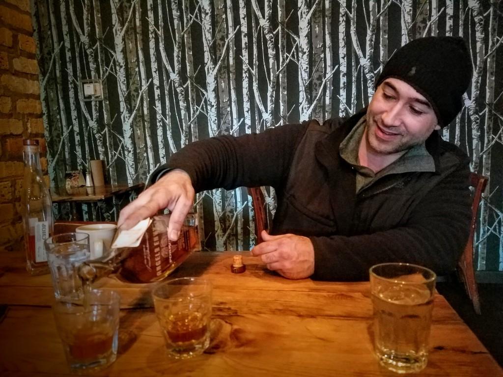 Jovanis Bouargoub pouring us a bourbon