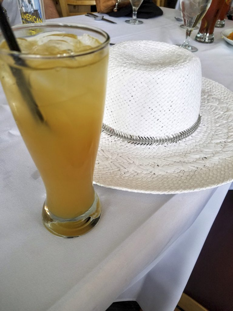 Race day essentials: hat and a cocktail.