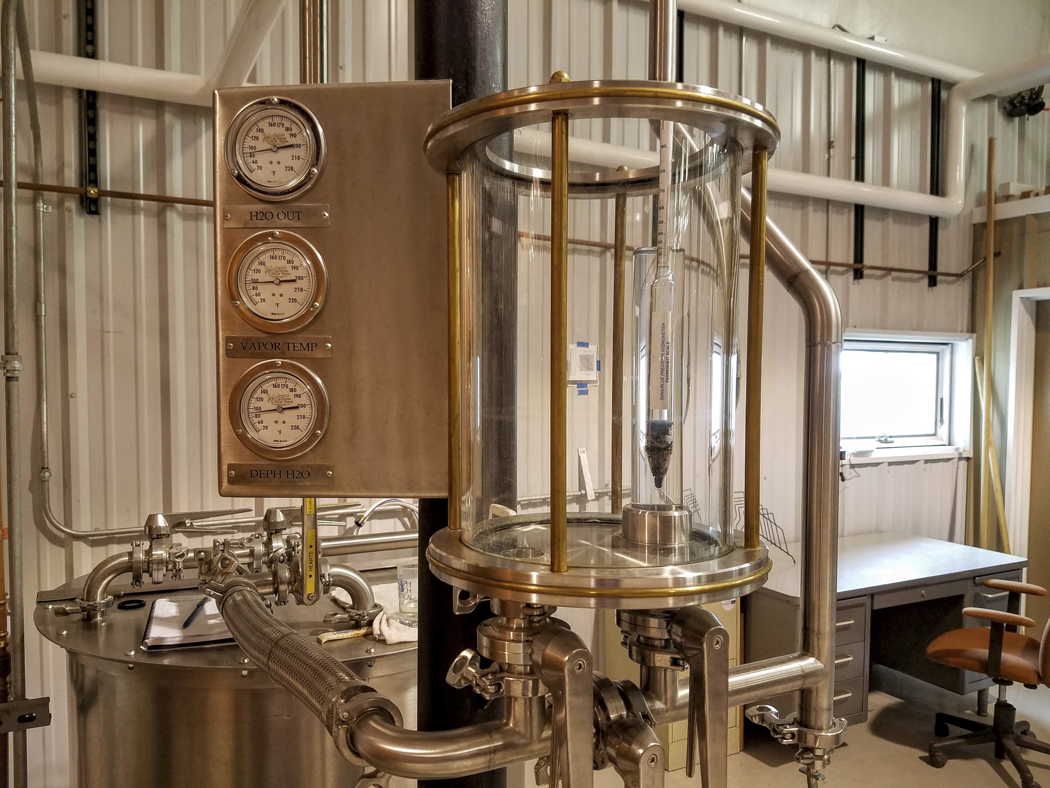 The hydrometer chamber used to measure the proof of alcohol coming off the still.