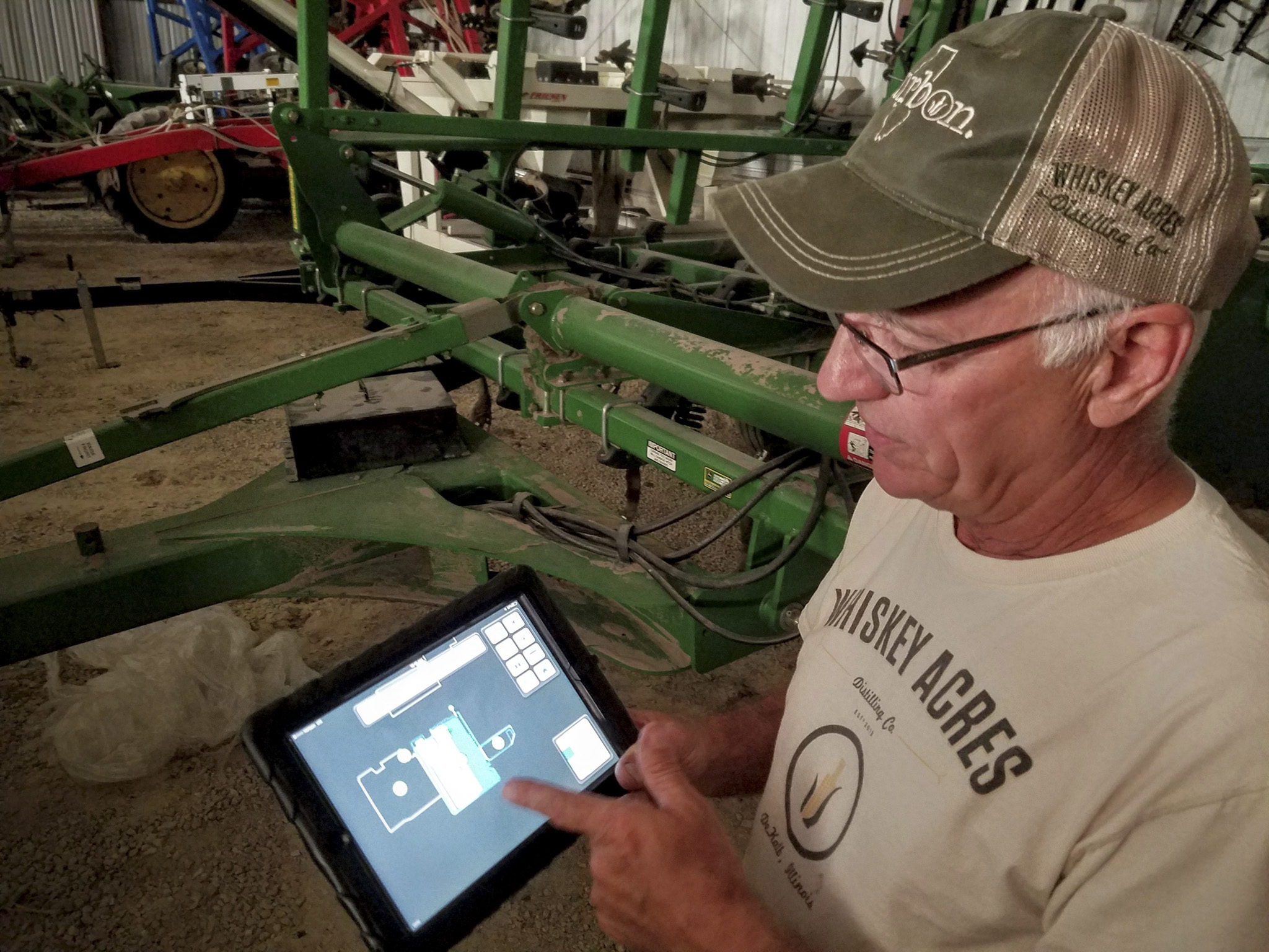 Jim Walter showing us the iPad used to control the farm equipment and monitor every aspect of their crops.