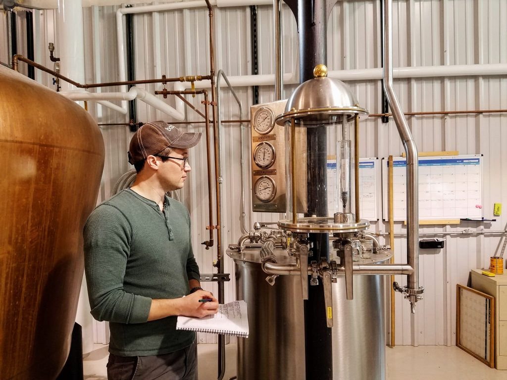 Rob checking gauges on the still