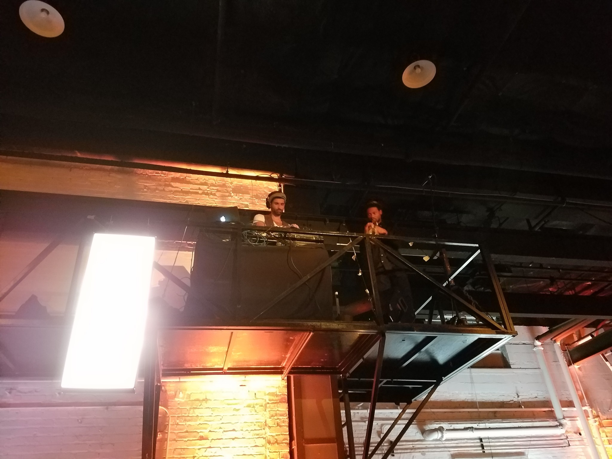 The jazz band playing from the rafters.