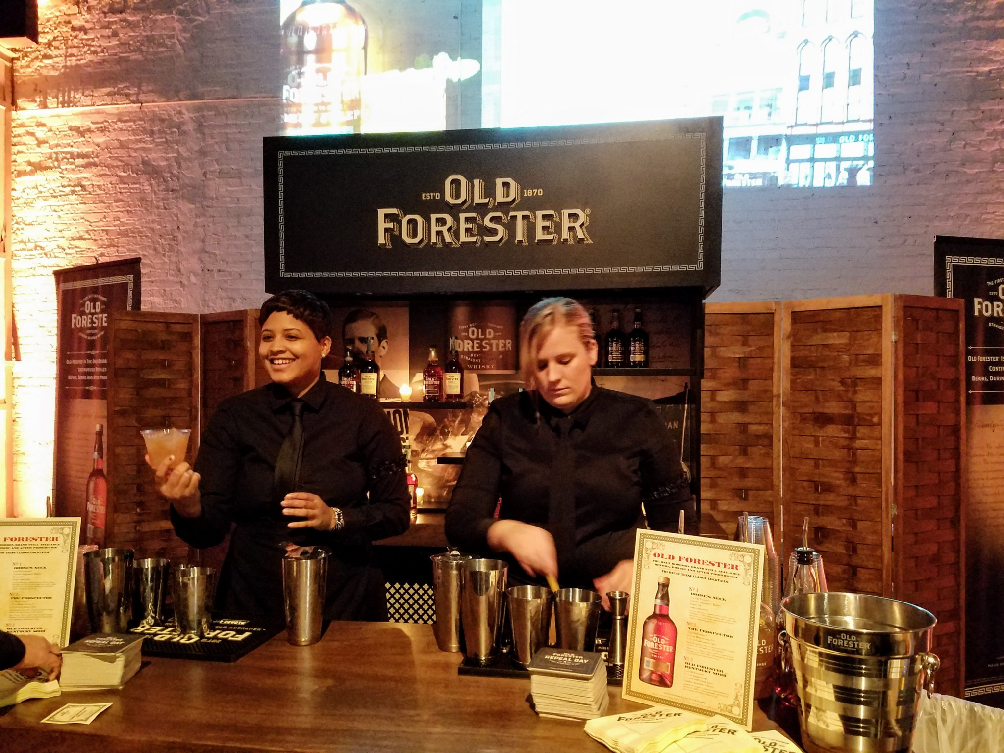 A couple bartenders having fun at the Old Forester booth.