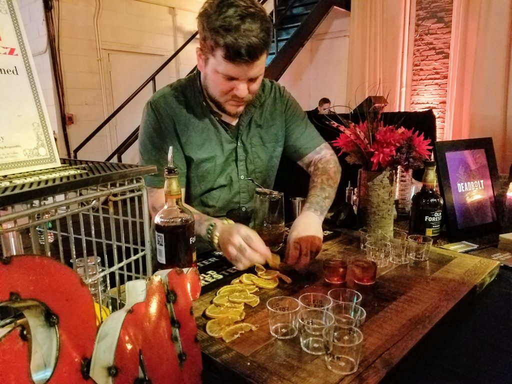 Dustin Drankiewicz crafting the 'Island Old Fashioned'. Made with Honey-Dem syrup and coffee bitters.