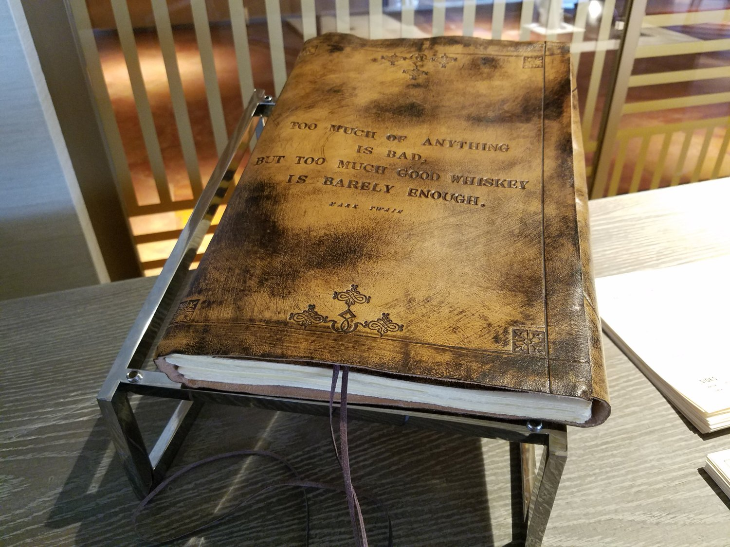The 'Bourbon Baron Program' log book. Join the program and keep track of your whiskey consumption in this book.