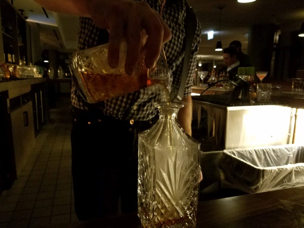 'The Huntsman' being poured into a tea smoke filled decanter.