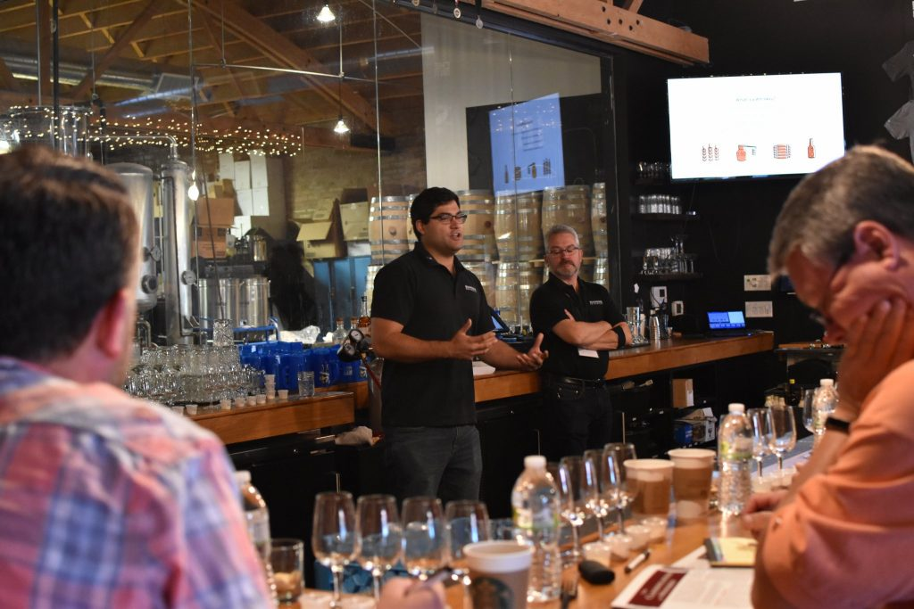 Instructors Tyler Gomez (left) and Kevin Hall (right) teaching at Chicago Distilling Company