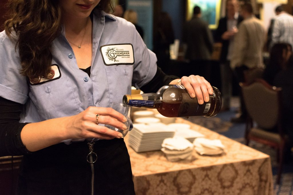 Pouring us a sample of Belle Meade from Nelson's Greenbrier Distillery