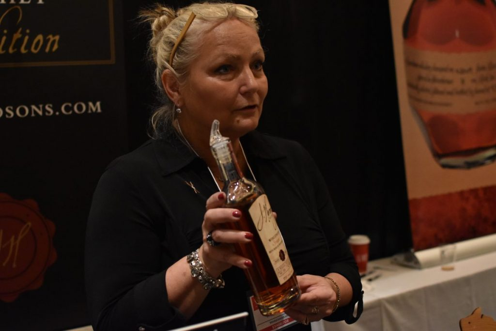 Liz Henry, Co-founder of Wisconsin's J. Henry & Sons pouring their award winning bourbon