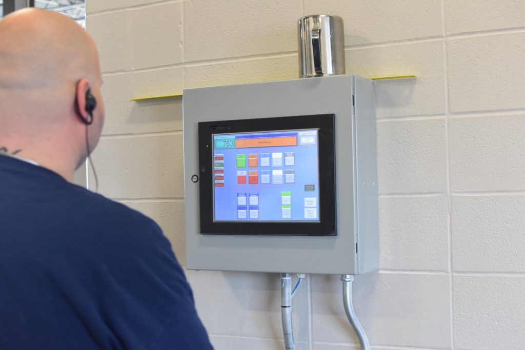 A distillery operator observes one of the many computer screens that monitor and guide distilling operations